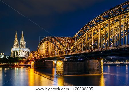 Night View Of Cologne Cathedral And Hohenzollern Bridge, Germany
