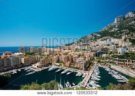 Yachts moored near city Pier, Jetty In Sunny Summer Day. Monaco,