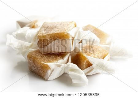 Pile Of Luxury Wrapped Caramel Toffees Isolated In Perspective.