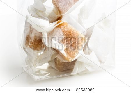 Detail Of Cellophane Packet Of Wrapped Caramel Toffees.