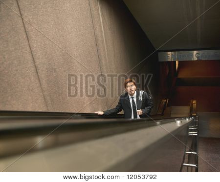 High angle view of man riding escalator