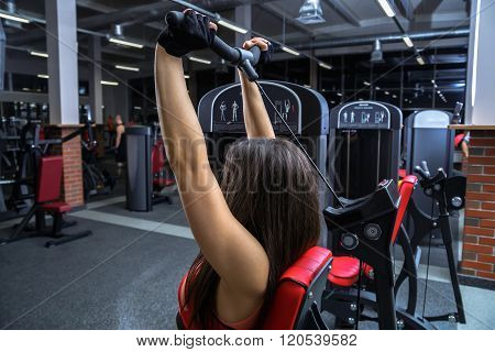 Athletic young woman work out with training apparatus