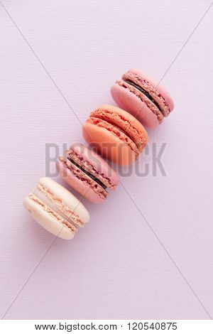 Close up of french sweet delicacy macaroons cookies colorful variety.