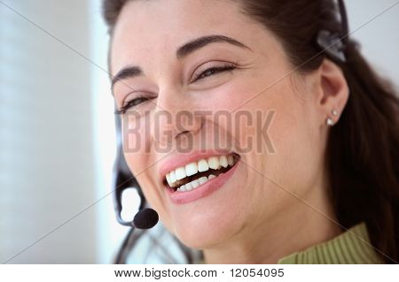 Close up of businesswoman talking with earpiece