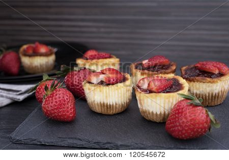 Mini Strawberry Cheesecake In Muffin Forms. Served In Black Stone Plateau With Fresh Strawberries. B