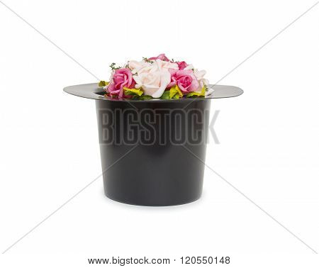 Black magic hat with flowers isolated on a white background