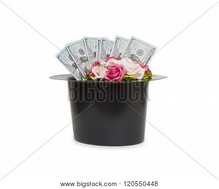 Money And Flowers In Black Magic Hat Isolated On A White Background