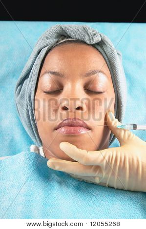 Young woman receiving facial injection