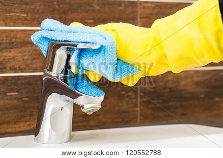 Woman Doing Chores In Bathroom.