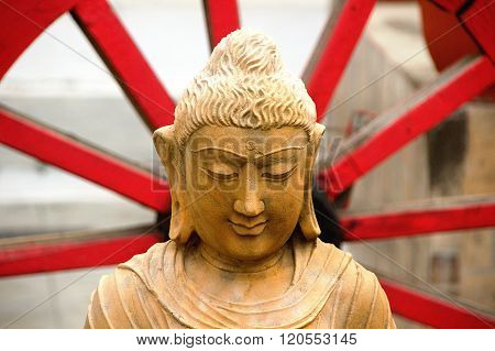 Wise And Serene Face Of Buddha
