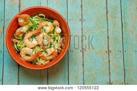 Spiralized Zucchini With Jumbo Shrimp On Wood Board