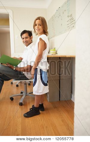 Young businessman talking to his son