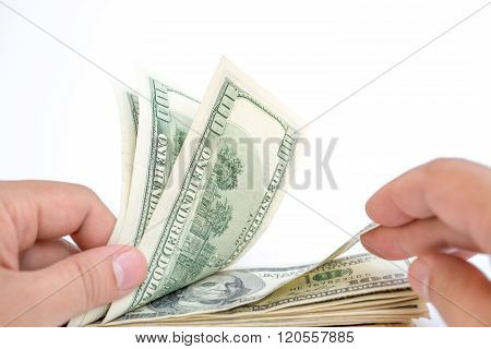 Counting Stack Of Usd Dollars On White With Clipping Path