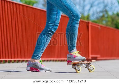 Human Legs Skater With Skateboard On Street.