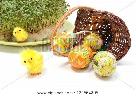 Easter Eggs In Overturned Wicker Basket And Green Watercress