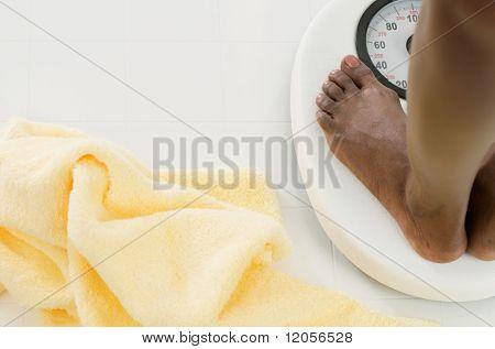 Bare feet on bathroom scale