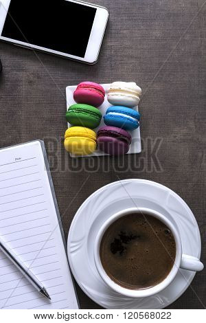 Cup Of Coffee  And Colorful Macaroons
