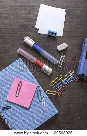 Mix Of Office Supplies On A Wooden Desk Background.