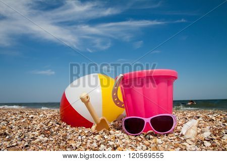 Child Bucket And Toys On Tropical Beach