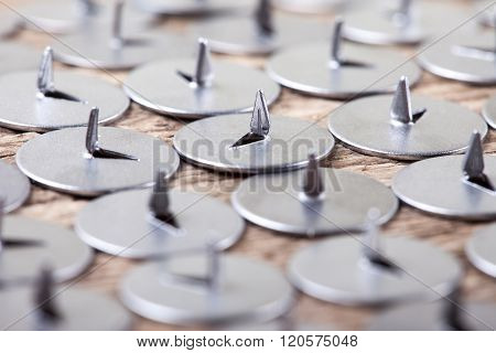 lot of pushpin on an old wooden surface macro background