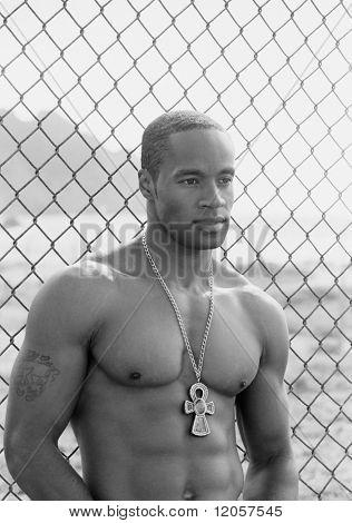 Young shirtless man wearing a pendant