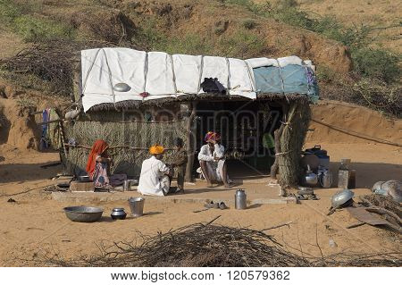 Poor Family Near The Straw Hut In The Thar Desert. Rajasthan, India