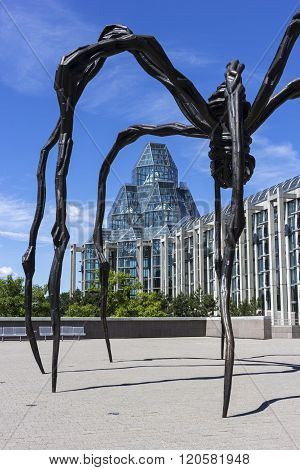 OTTAWA, ONTARIO, CANADA - JUNE 21, 2014: Maman sculpture by the artist Louise Bourgeois in front of National Gallery of Canada in Ottawa