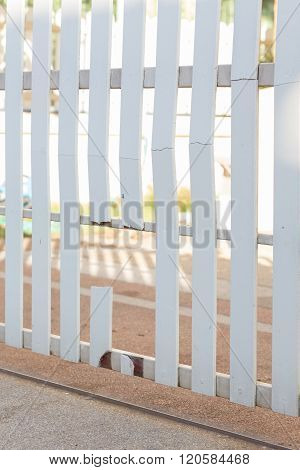 White Wood Fence Of Broken Damaged