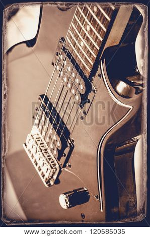 Part of electric guitar on wooden background. Old style.