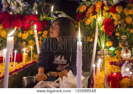 OAXACA MEXICO - NOV 02 : Unidentified woman on a cemetery during Day of the Dead in Oaxaca Mexico on November 02 2015. The Day of the Dead is one of the most popular holidays in Mexico