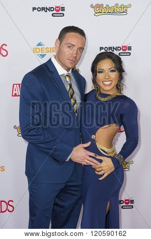 LAS VEGAS - JAN 23 : Adult film actor Romeo Price (L) and adult film actress Morgan Lee attend the 2016 Adult Video News Awards at the Hard Rock Hotel & Casino on January 23 2016 in Las Vegas.