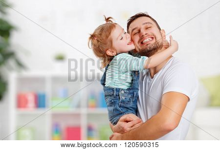 Happy Family And Father's Day. Daughter Kissing And Hugging Dad