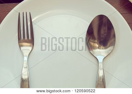 Dishware Set On Wood Table With Plate, Spoon And Fork