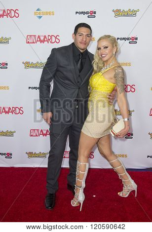 LAS VEGAS - JAN 23 : Adult film actor Tony Martinez (L) and adult film actress Nina Elle attend the 2016 Adult Video News Awards at the Hard Rock Hotel & Casino on January 23 2016 in Las Vegas.