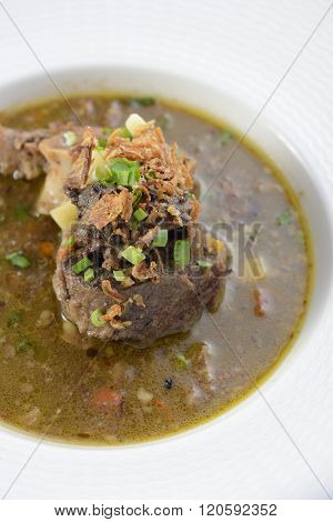 Oxtail Soup on a white bowl