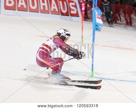 Skier Nina Loeseth Skiing At A Slalom Event
