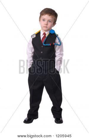 Garoto vestido como um doutor