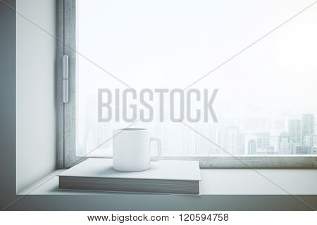 Window With White Coffee Cup And Book
