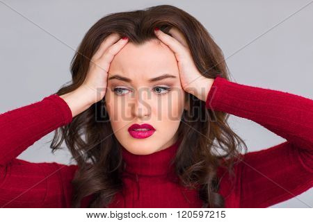 Exhausted woman touching her head