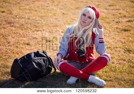 Beautiful Blonde Young Woman In Posing Outdoors