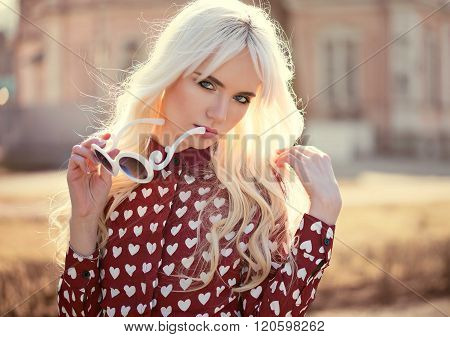 Portrait Of Beautiful Blonde Young Woman Outdoors