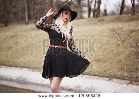 Pretty Womanl In Posing Outdoors
