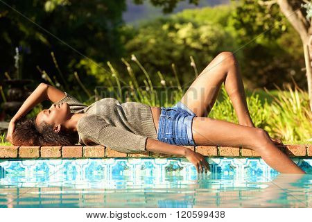 African Woman Lying By Pool