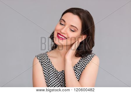 Pleasant woman binding her head