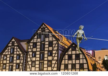 Old town view with famous statue on the rope with old Granaries in the background in Bydgoszcz Poland