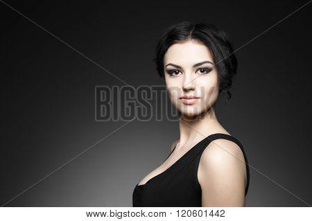 Portrait of beautiful female model on gray background