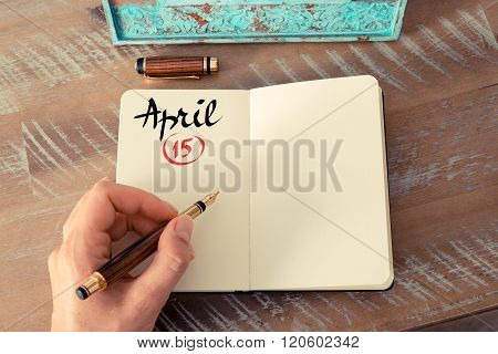April 15 Calendar Day Handwritten On Notebook