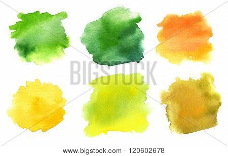 A set of abstract watercolour stains in the green and golden colours of summer and autumn, on white
