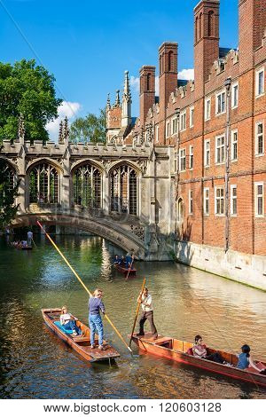 Tourists On Punt Trip Along River Cam Near Bridge Of Sighs Of St John's College, Cambridge, England
