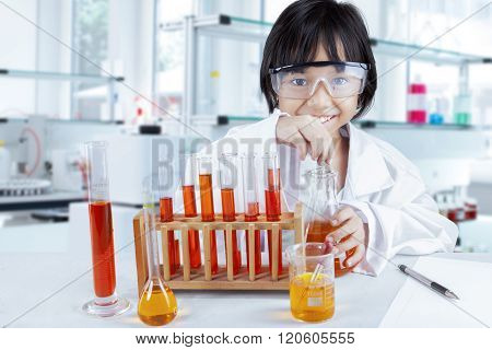 Curious Schoolgirl Doing Research